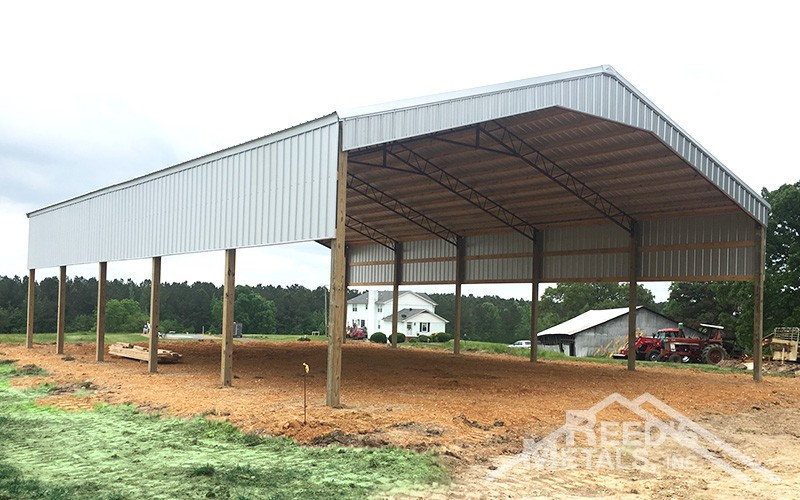 Galvalume 40x60x14 Roof Only Pole Barn with Partially Sheeted Walls Images